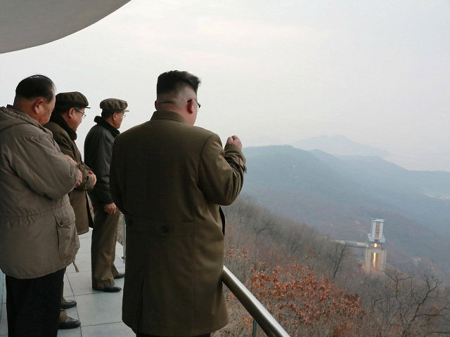 This undated picture released by North Korean official Korean Central News Agency (KCNA) on March 19, 2017 shows North Korean leader Kim Jong-Un (R) inspecting the ground jet test of a newly developed high-thrust engine at the Sohae Satellite Launching Ground in North Korea. North Korea has tested a powerful …