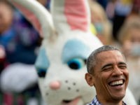 President Barack Obama, joined by the Easter Bunny, greets members of the audience on the South Lawn at the White House Easter Egg Roll at the White House in Washington, Monday, March 28, 2016. Thousands of children gathered at the White House for the annual Easter Egg Roll which features …