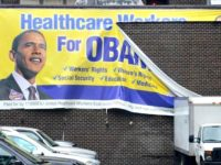 obamacare_banner_torn_ap_photo_2