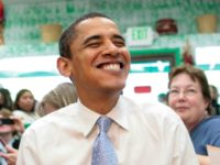 Democratic presidential hopeful, Sen. Barack Obama, D-Ill., shares a laugh with diners while having lunch at Luis's Taqueria in Woodburn, Ore., Friday, May 9, 2008. (AP Photo/Jae C. Hong)
