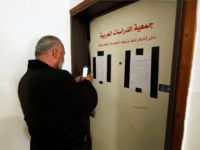 A man takes a photo of the sealed offices of Khalil Tufagji, a prominent Palestinian cartographer, in east Jerusalem, Tuesday, March 14, 2017. Israeli police have raided Tufagji's office accusing him of working illegally on behalf of the Palestinian Authority. In a statement, police accused Tufagji of conducting research for …