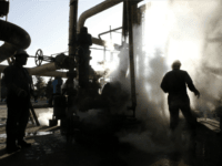 FILE - In this Nov. 17, 2007 file photo, a worker repairs a part of a unit of the Tehran oil refinery, in Tehran, Iran. A series of fires at Iranian petrochemical plants and facilities have raised suspicions about hacking potentially playing a role in the blazes. Iran officially insists …