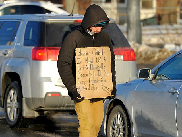PORTLAND, ME - JANUARY 9: Dana Burnell, a panhandler walking the median strip at the corner of Franklin and Somerset Street, said he read about the possibility of being banned from the medians and said it would severely hurt the homeless who depend on getting money to survive. Recently kicked …