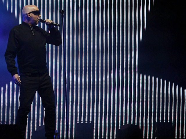 "British musician Neil Tennant of the Pet Shop Boys performs at the Cumbre Tajin 2013 music festival in Papantla, Mexico, early Saturday March23. 2013. With this show, Pet Shop Boys kicked off their world tour to promote their upcoming album, ""Electric"".(AP Photo/Felix Marquez)"