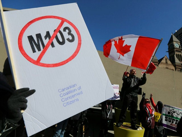 Opponents of the anti-Islamophobia federal government motion M-103 wave Canadian flags during a rally outside City Hall in Toronto, Ontario, Canada March 4, 2017. REUTERS/Chris Helgren