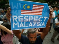 "A members of the UMNO (United Malays National Organization) Youth holds up a placard as they gather to protest against the killing of Kim Jong Nam outside North Korean Embassy in Kuala Lumpur, Malaysia, Thursday, Feb. 23, 2017. North Korea denied Thursday that its agents masterminded the assassination of the half brother of leader Kim Jong Un, saying a Malaysian investigation into the death of one of its nationals is full of ""holes and contradictions."" (AP Photo/Vincent Thian)"