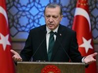 Turkey's President Recep Tayyip Erdogan addresses during an award ceremony in Ankara, Turkey, Thursday, Dec. 29, 2016. Turkey on Thursday rejected Washington's denials that it has provided weapons to a Syrian Kurdish militia force which Ankara considers to be a terrorist group and again complained about a lack of support from the U.S.-led coalition to its offensive against the Islamic State group in northern Syria. (Yasin Bulbul, Presidential Press Service, Pool photo via AP)