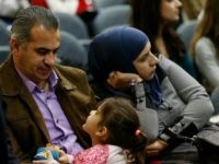 Syrian refugee Morad Alteibawi, left, talks to his 4-year-old daughter, Roma, as his wife Ola Alteibawi listens to United Nations Ambassador Samantha Power speaks at Seton Hall University, Wednesday, Jan. 13, 2016, in South Orange, N.J. Power said the president's foreign policy has successfully engaged foes and galvanized allies to …