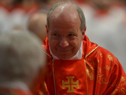 Austrian cardinal Christoph Schonborn attends a mass at the St Peter's basilica before the conclave on March 12, 2013 at the Vatican. Cardinals moved into the Vatican today as the suspense mounted ahead of a secret papal election with no clear frontrunner to steer the Catholic world through troubled waters …