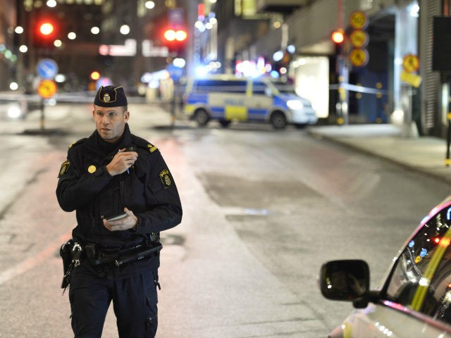 Police is seen near the shopping mall 'Moodgallerian' and a car tunnel in central Stockholm, after an explosion on January 26, 2016. The explosion caused damages to a car and a building, but no injuries are reported. The police are investigating the cause of the explosion. / AFP / TT …