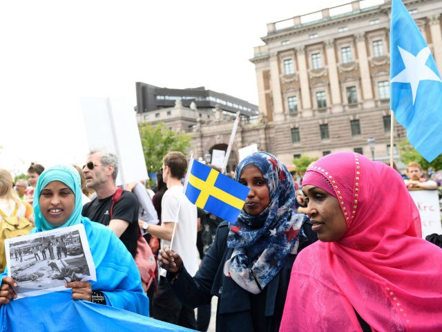 Protesters gather in front of Sweden's parliament in Stockholm on June 21, 2016 to protest the newly approved legislation to tighten regulations for asylum and family reunification in the Scandinavian country which had a record 160,000 asylum-seekers last year. / AFP / TT News Agency / Henrik MONTGOMERY / Sweden OUT (Photo credit should read HENRIK MONTGOMERY/AFP/Getty Images)