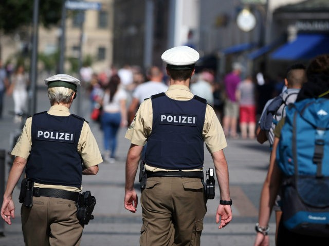 Policemen patrol through a pedestrian area in Munich, southern Germany, on July 23, 2016, one day after the attack at the shopping centre in Munich. Police were probing the motives of the lone teenage German-Iranian gunman who went on a deadly rampage at a busy Munich shopping centre, the third …