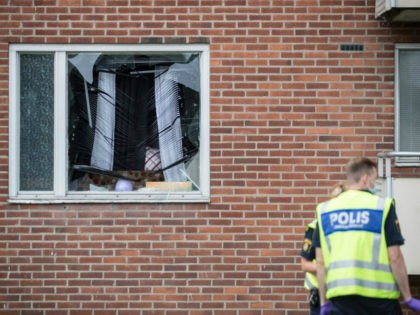 Forensic police investigates on August 22, 2016 an area in Gothenburg, where an explosion demolished an apartment the night before. An eight-year-old boy was killed Monday night when a grenade was thrown into the apartment in Sweden where he was sleeping, police said, adding he was likely the victim of …