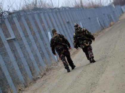 Border soldiers patrol along the border fence on the Hungarian-Serbian border near the village of Roszke on February 24, 2017. The Hungarian defence forces have been performing construction and security tasks along the whole length of the more than 300-km-long temporary security barrier since July 2015. Several thousand soldiers patrol …