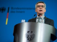 German Interior Minister Thomas de Maiziere gives a press conference on March 14, 2017 in Berlin after a meeting with the steering committee of the German Conference on Islam. De Maiziere said Ankara was playing the role of the victim with its broadsides against NATO allies, as it seeks to …