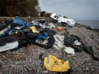 The wreckage of a boat and life jackets used by refugees lie on a beach near Skala Sykamias on the island of Lesbos on March 15, 2017 almost a year after an EU-Turkey deal. The deal, signed on March 18, 2016, has sought to stem the flow of migrants from …
