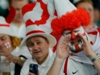 England fans wait for the start of the Rugby World Cup Pool A match between England and Wales at Twickenham Stadium, London, Saturday, Sept. 26, 2015. (AP Photo/Frank Augstein)
