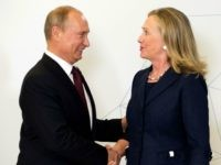 US Secretary of State Hillary Clinton (R) shakes hands with Russian President Vladimir Putin during the arrival ceremony for the Asian-Pacific Economic Cooperation (APEC) Summit in Vladivostok on September 8, 2012. AFP PHOTO/POOL/Jim WATSON
