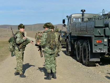 2972439 11/11/2016 Servicemen of the Nuclear, biological and chemical (NBC) defense troops of the Russian Army during special tactical exercises in Ingushetia on emergency response to chemical and biological incidents. Said Tsarnaev/Sputnik via AP