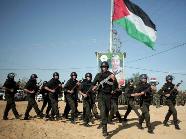Palestinian Hamas security forces deploy on the Palestinian side of the border with Egypt in Rafah, southern Gaza Strip, Thursday, April 21, 2016. Hamas has deployed forces along the Egyptian-Gaza border to counter Cairo's concerns it is aiding militants from the Islamic State group in Egypt's lawless Sinai Peninsula. (AP …