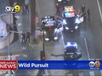 Slow-Speed Chase Ends with Suspect Smoking Cigarette by Hollywood Walk of Fame