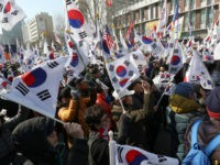 Pro- President Park Guen-Hye hold the national flag near the South Korea's Constitutional Court in Seoul, South Korea on March 10, 2017, after the impeachment of President Park Geun Hye was upheld by the court vote. According to the local police, two people were killed in the protest. Presidential election will be held in 60 days. ( The Yomiuri Shimbun via AP Images )