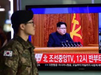 A South Korean soldier walks past a television screen showing a broadcast of North Korean leader Kim Jong-Un's New Year speech, at a railroad station in Seoul on January 1, 2016. North Korean leader Kim Jong-Un said raising living standards was his number one priority in an annual New Year's …