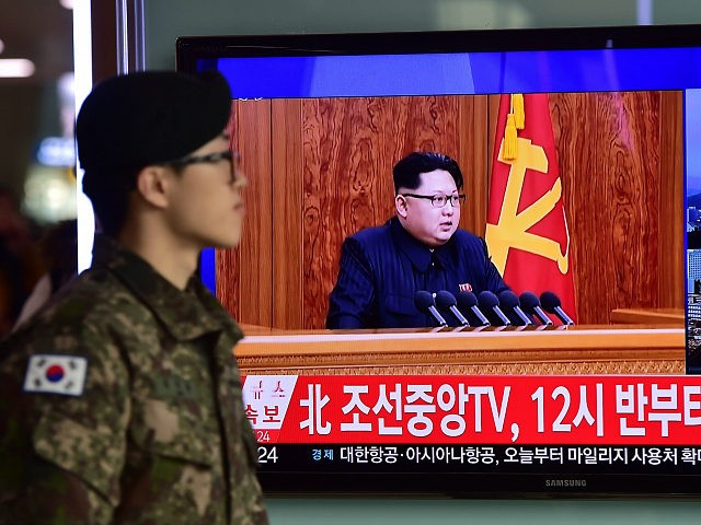 A South Korean soldier walks past a television screen showing a broadcast of North Korean leader Kim Jong-Un's New Year speech, at a railroad station in Seoul on January 1, 2016. North Korean leader Kim Jong-Un said raising living standards was his number one priority in an annual New Year's address on January 1 that avoided any explicit reference to the country's nuclear weapons programme. AFP PHOTO / JUNG YEON-JE / AFP / JUNG YEON-JE (Photo credit should read JUNG YEON-JE/AFP/Getty Images)