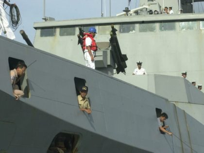 Taiwanese Navy sailors and officers dock the guided-missile frigate Hsi-Ning as it pulls into the port ahead of another frigate and a fuel and munitions supply ship to begin a two-day port call with a crew of 800 sailors and midshipmen in Port-au-Prince, Haiti, on Thursday, May 1, 2003. (AP …