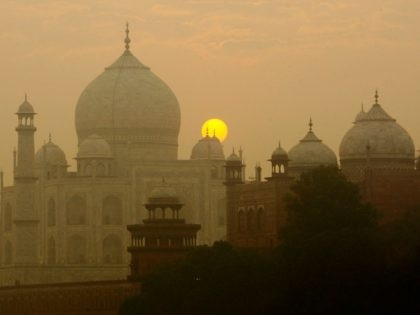 FILE - In this Nov. 18, 2009, file photo, the sun rises over the Taj Mahal in Agra, India. Archaeological experts say insects proliferating from a polluted river near the Taj Mahal are marring the intricate marble inlay work by leaving greenish black patches of waste on the walls of …