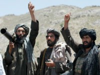 FILE - In this May 27, 2016 file photo, Taliban fighters react to a speech by their senior leader in the Shindand district of Herat province, Afghanistan. Two senior Taliban figures said that Pakistan has issued a stark warning to the militant group, apparently surprised over being excluded from the …