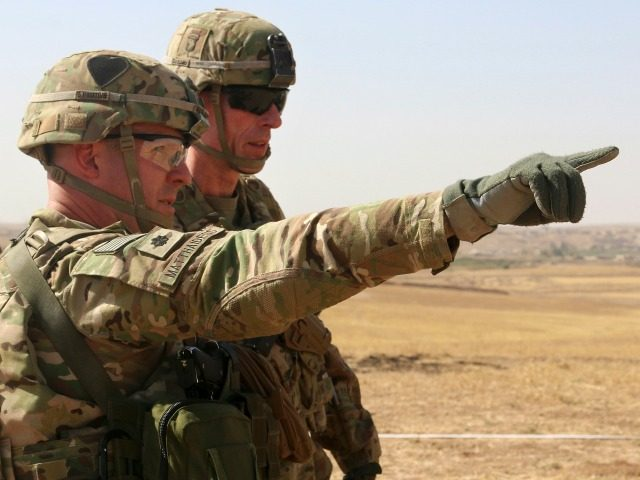 U.S. Army Lt. Col. Ed Matthaidess, commander, left, Task Force Falcon, outlines areas of an Iraqi security forces tactical assembly area to U.S. Army Maj. Gen. Gary J. Volesky, commander, Combined Joint Forces Land Component Command – Operation Inherent Resolve, in northern Iraq, prior to the start of the Mosul …