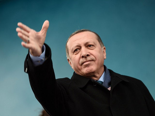 Turkish President Recep Tayyip Erdogan gestures at supporters during a rally in Istanbul on March 11, 2017. Erdogan threatened to retaliate after the Netherlands banned the foreign minister from flying in for a campaign rally, as he said The Hague's behaviour was reminiscent of Nazism. Turkish politicians are keen to …