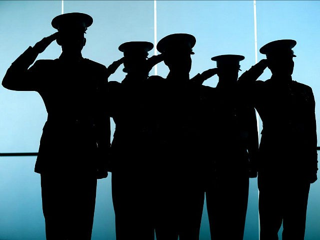 BOSTON, MA - NOVEMBER 13: Marines standing near the glass doors of the Convention Center salute during the National Anthem at the Boston Convention and Exposition Center in Boston on Nov. 13, 2015. A 240th Birthday of the United States Marine Corps luncheon was held, where Marine Corps General Joseph Dunford, Chairman of the Joint Chiefs of Staff was in attendance. (Photo by John Tlumacki/The Boston Globe via Getty Images)