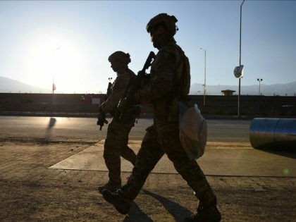 US soldiers arrive at the site of a suicide car bombing that targeted an Afghan police district headquarters building as a gun battle continues between Taliban and Afghan security forces in Kabul on March 1, 2017. Explosions and gunfire echoed through Kabul after near simultaneous Taliban suicide assaults on two …