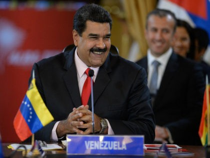 Venezuelan President Nicolas Maduro smiles while giving a speech during the Bolivarian Alliance for the Peoples of Our America (ALBA) summit at the Miraflores presidential palace in Caracas on March 5, 2017. The extraordinary summit is paying homage to late Venezuelan leader Hugo Chavez, on the fourth anniversary of his …