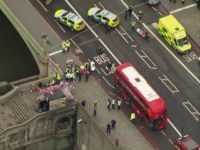 In this image taken from video emergency personnel gather around a body on the southside of Westminster Bridge that leads to the Houses of Parliament in London, Wednesday, March 22, 2017 after the House of Commons sitting was suspended as witnesses reported sounds like gunfire outside. The leader of Britain's …