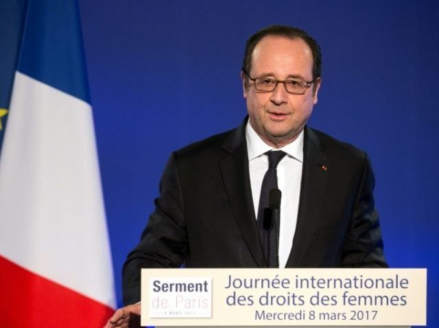 French President Francois Hollande delivers a speech during a meeting as part of the 40th International Women's Day on March 8, 2017, at the French Foreign Affairs Ministry in Paris