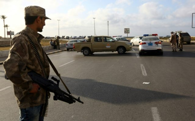 Forces loyal to Libya's Government of National Accord (GNA) man a checkpoint in the Hay al-Andalus neighbourhood of Tripoli on March 14, 2017, following clashes between rival armed groups