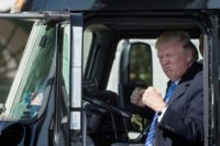 US President Donald Trump sits in the drivers seat of a semi-truck as he welcomes truckers and CEOs to the White House, in Washington, DC, on March 23, 2017