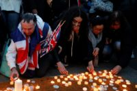 People in London light candles in tribute to the victims of the attack outside the British parliament that killed three people