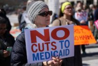 Activists demonstrate against the Trump healthcare plan during a rally in Washington DC, on March 23, 2017
