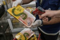 The staff of Rio de Janeiro state's consumer protection agency, PROCON, checks the temperature of frozen chicken products at a supermarket in Rio de Janeiro, Brazil, on March 24, 2017