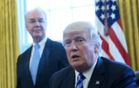 US President Donald Trump, with Health and Human Services Secretary Tom Price (L), speaks from the Oval Office of the White House in Washington, DC, on March 24, 2017