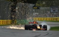 Sparks fly from beneath the car as Red Bull's Australian driver Daniel Ricciardo takes part in the qualifying session for the Formula One Australian Grand Prix in Melbourne on March 25, 2017