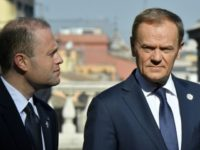 EU President Donald Tusk (R) speaks with Malta's prime minister Joseph Muscat ahead of a special summit of EU leaders to mark the 60th anniversary of the bloc's founding Treaty of Rome, on March 25, 2017 at Rome's Piazza del Campidoglio