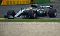 Lewis Hamilton in a Mercedes clocked a record lap of one minute 22.188 seconds to take his 62nd career pole and sixth in Australia into Sunday's race in Melbourne
