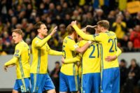 Sweden's midfielder Emil Forsberg celebrates with his teammates after scoring during their FIFA World Cup 2018 qualifier against Belarus in Solna on March 25, 2017