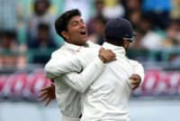 India's Kuldeep Yadav (L) celebrates the wicket of Australia's Peter Handscomb with teammate Murali Vijay during the fourth and final Test at The Himachal Pradesh Cricket Association Stadium in Dharamsala on March 25, 2017