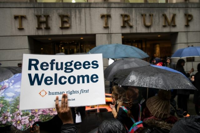 Protestors rally in front of the Trump Building on Wall Street during a protest against the administration's proposed travel ban and refugee policies